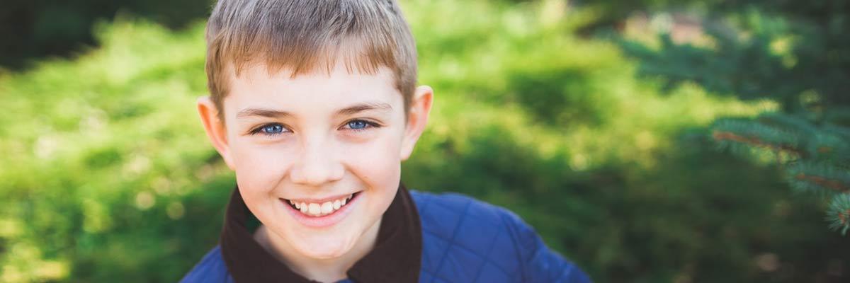 a healthy boy smiling